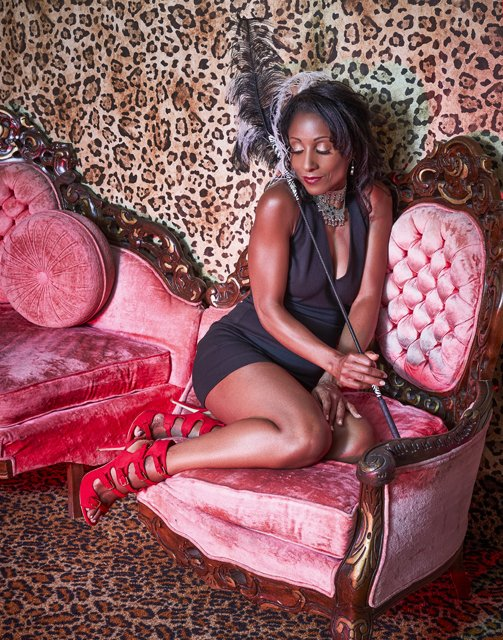 deidra-alexander-on-a-pink-chair-with-feathers-and-red-shoes